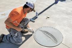 Scotty Carpenter & Chance Trube apply caulk at the IGSFMM site.