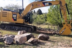 Landscaping rock donated by Ryan Perrigoue: A Touch Of The Cascades Landscaping. Equipment donated by Western States Cat