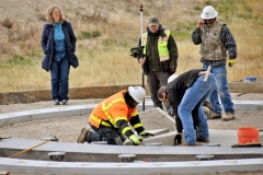Rebecca Webb and Chris Adams from Creek Hollow & Associates watch granite being placed at the IGSFMM.