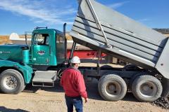 Idaho Rock & Sand delivering black basalt rock to the IGSFMM site.