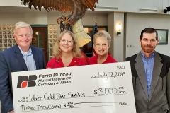 Farm Bureau Sponsor Check Presentation. Pictured (left to right): Paul Robert, Farm Bureau CEO, Rebecca Webb, Jean Haneke,  Jason Williams,  Farm Bureau Treasurer
